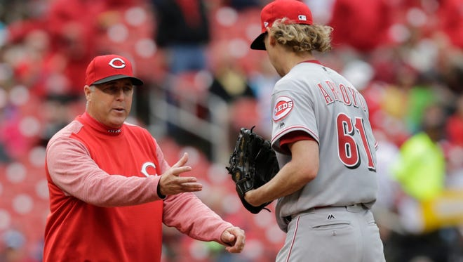 Cincinnati Reds manager Bryan Price, left, asks for the ball as he pulls starting pitcher Bronson Arroyo in the fifth inning of a baseball game against the St. Louis Cardinals, Sunday, April 30, 2017, in St. Louis. (AP Photo/Tom Gannam)