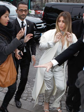 Kardashian does the fashion circuit solo. Here, she's attending Stephane Rolland's show in Paris on Jan. 21.
