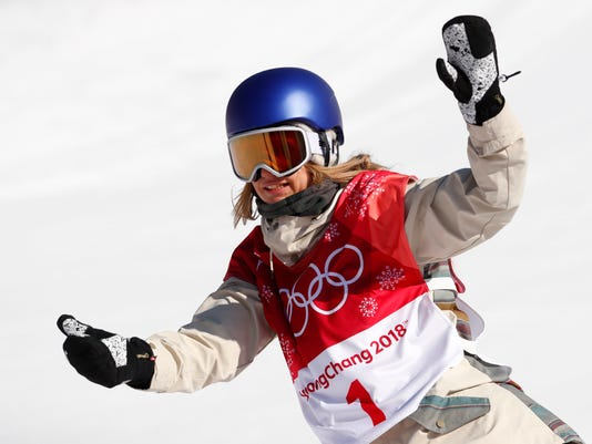 Anna Gasser, of Austria, reacts after her second jump in the women's Big Air snowboard final at the 2018 Winter Olympics in Pyeongchang, South Korea, Thursday, Feb. 22, 2018. (AP Photo/Matthias Schrader)