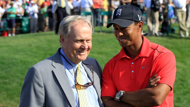 In this June 3, 2012 file photo, Jack Nicklaus, left, talks with Tiger Woods after Woods won the Memorial golf tournament at the Muirfield Village Golf Club in Dublin, Ohio.