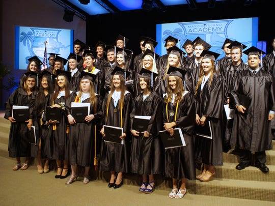 The Marco Island Academy graduates group together for a class photo.