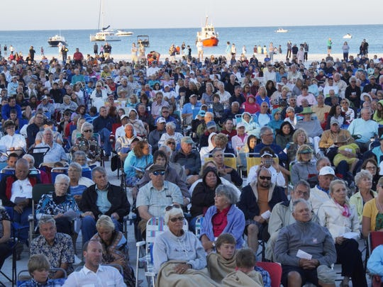 File: The Marco Easter Sunrise service on the beach attracts thousands.