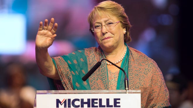 Presidential candidate Michelle Bachelet waves at her closing campaign rally in Santiago, Chile, on Nov. 14, 2013.