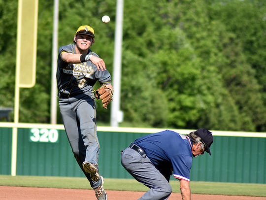 Hendersonville shortstop Brett Coker throws to first
