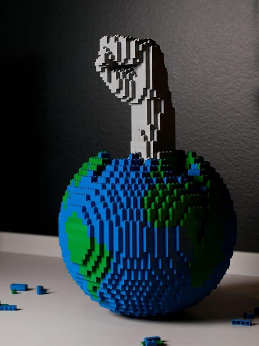 Globe with Fist