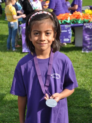 Maya Leachman, then 6, was a top fundraiser in the 2014 Walk to End Alzheimer's in Monroe County.  This year, she hopes to raise even more with her lemonade stand.
