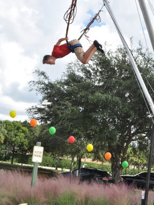 On Saturday, November 7, Bonita Springs Charter School held a Harvest Fest. Guests enjoyed face painting, a rock wall, a bounce house, multiple games, and a bake sale.