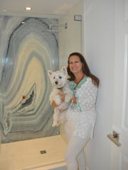 Susan Ostrowski loves the decorative art panel in the guest bathroom.