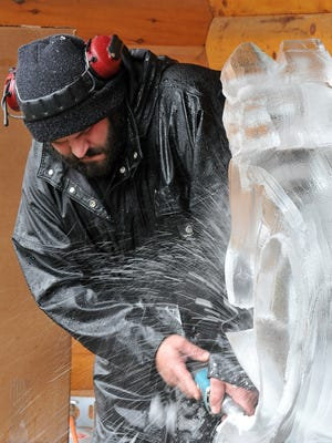 Jeff Meyers of Elegant Ice Creations sculpts a horse during the Mohican Winterfest in downtown Loudonville last year.