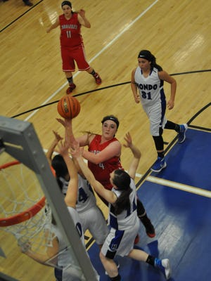 Lady Grizzly Kristie Gallacher makes a shot as Hondo's girls swarm her at the basket.
