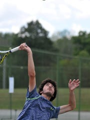 Christian Zupan, shown here earlier in the season, won a Division II sectional singles title for Lexington on Saturday at Lakewood Racquet Club.
