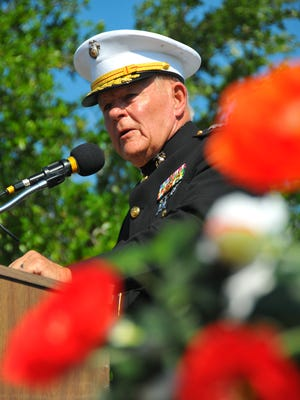 Keynote speaker USMC Lt. Gen. Robert Winglass, Ret., framed by flowers from a Gold Star Mothers wreath, gave a powerful speech to the crowd. Hundreds showed up for the Memorial Day Ceremony at the Brevard Veterans Center on Merritt Island Monday morning.