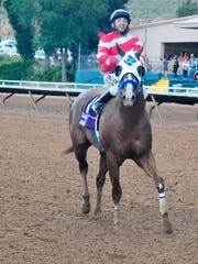 Jess Good Candy and jockey Ivan Carnero after the win.
