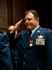 """U.S. Air Force Col. Clarence """"Ski"""" Borowski salutes U.S. Air Force Col. Randy Efferson, 187th Fighter Wing commander, after receiving the Legion of Merit on Aug. 7 at the OG change of command ceremony at Montgomery Regional Air National Guard Base."""
