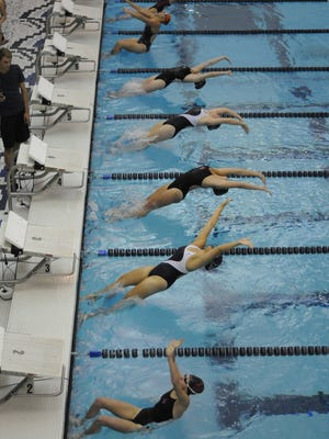 Swimmers start the 100 backstroke at the St. Clair County girls swim meet on Sept. 29, 2016.