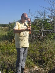 FGCU associate professor Phil Allman and his students use telemetry to track tortoises at Delnor-Wiggins State Park.