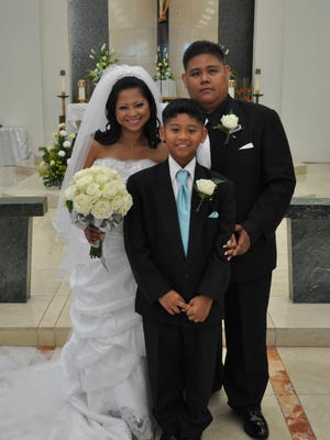 Cedrick Maravilla and his wife Aileen and son Cyril in 2010