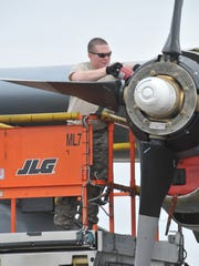 120th Airlift Wing Staff Sgt. Justin Stevens works on an engine in Great Falls in April.