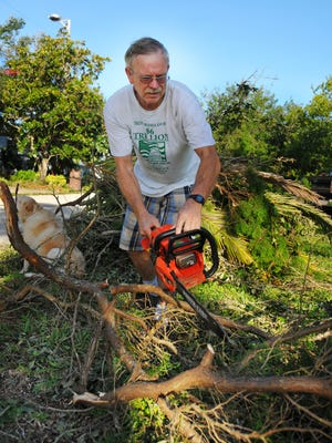 Rick Hildreth cuts up limbs from fallen trees in his Cocoa Beach neighborhood after Hurricane Matthew in October 2016. United Way of Brevard says volunteers will be needed for months to come after Hurricane Irma.