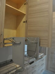 Cabinets have pull down racks for easy access.