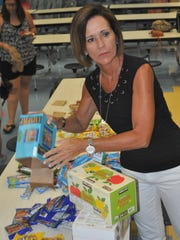 Assistant principal Diane Santacrose packs snack bags at Sea Gate Elementary School.