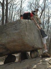 A Pyramid Mountain hike leads to Tripod Rock, carried