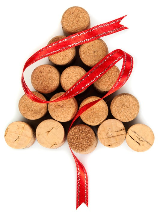 Christmas tree shaped arrangement of corks with red ribbon