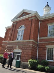 Matt Webster and Karen Franxman, former city of Union events coordinator, examine the exterior of the historic Boone County Courthouse in 2015.