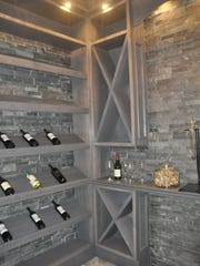 This home features a 500-bottle wine cellar with an alligator skin ceiling.