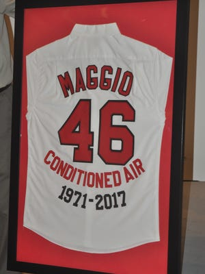 Frank Maggio was presented with a jersey retiring his name and number 46 for the number of years he worked for Conditioned Air. The company held a retirement party for him Wednesday, Jan. 16.