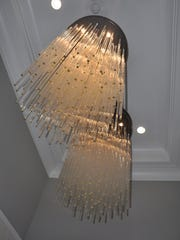 Interesting chandeliers are found in every room including
