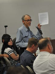 Don Hancock asks representatives of the Nuclear Regulatory Commission to consider the repercussion of allowing the construction of a spent nuclear fuel rod interim storage facility near Carlsbad, N.M. during a scoping meeting May 3.