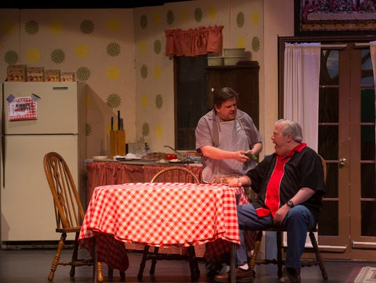 """Steve Borstein, left, and Tim Bagley rehearse a scene from the Theater Ensemble Arts production of """"Dinner with the Boys"""" Tuesday at the Totah Theater in Farmington."""