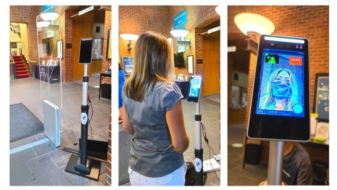 A thermal body temperature monitoring system checks patrons for signs of fever before they are allowed to enter the Plymouth Public Library.