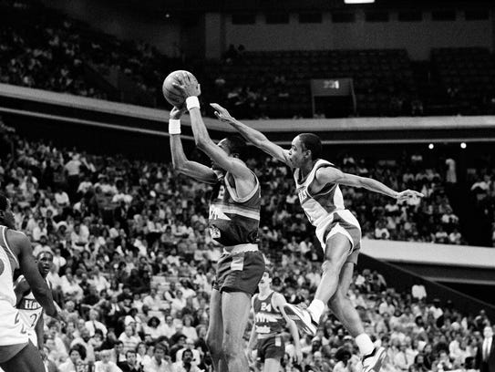 Atlanta Hawks' Spud Webb (4) sails up and almost over