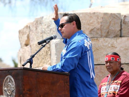 Carlos Hisa, Tigua Tribal Governor, speaks at statue dedication.