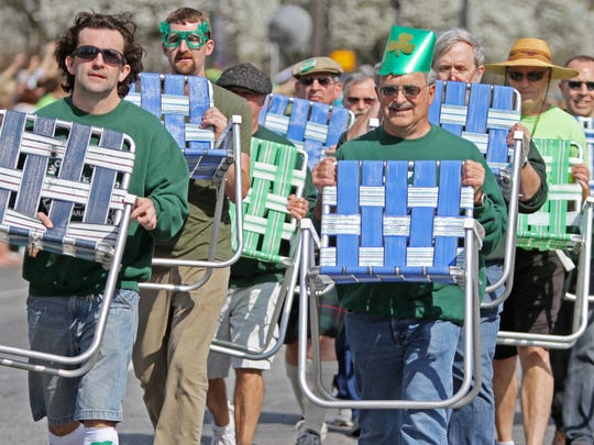Members of the Woodruff Lawnchair Brigade march in sync during the 32nd annual St. Patrick's Day Parade in downtown Indianapolis, Friday, March 16, 2012.  Kelly Wilkinson / The Star