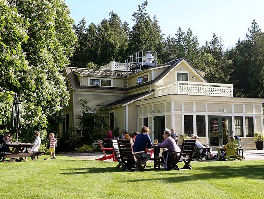 Diners enjoy the sunshine on the lawn for the Tuesday