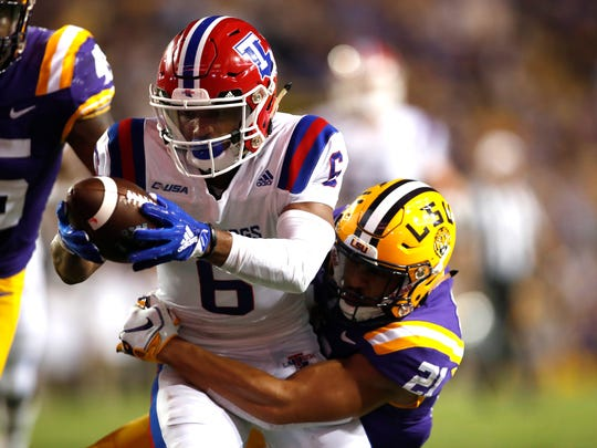 Louisiana Tech wide receiver Adrian Hardy (6) runs past LSU safety Ed Paris (21) to score a touchdown in the first half of an NCAA college football game against in Baton Rouge, La., Saturday, Sept. 22, 2018. (AP Photo/Tyler Kaufman)
