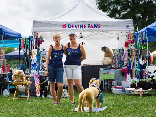 Michaela Devine of Dover and Edna Perrone of Dover at the Delaware Pride Festival on Legislative Mall on Saturday.
