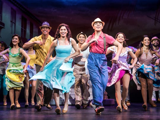 "Christie Prades is seen here as Gloria Estefan, along with Adriel Flete and the rest of the company of ""On Your Feet!"""