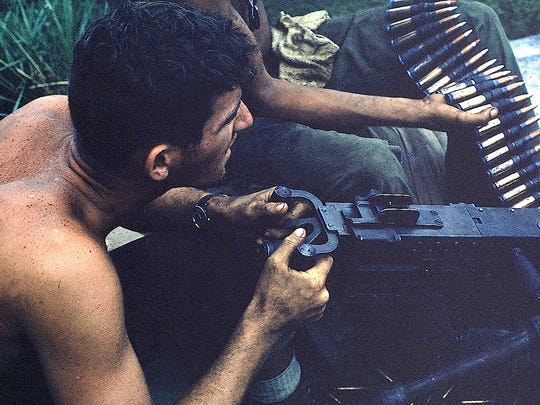 Ray Taylor serving as a machine-gunner in Vietnam.