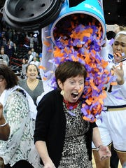 Muffet McGraw is doused in confetti after a game against