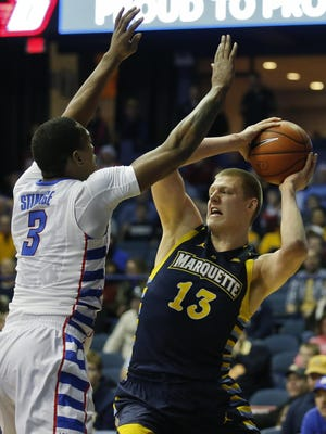 Feb 20, 2016; Rosemont, IL, USA; Marquette Golden Eagles forward Henry Ellenson (13) looks to pass the ball against DePaul Blue Demons forward Rashaun Stimage (3) during the first half at Allstate Arena. Mandatory Credit: Kamil Krzaczynski-USA TODAY Sports
