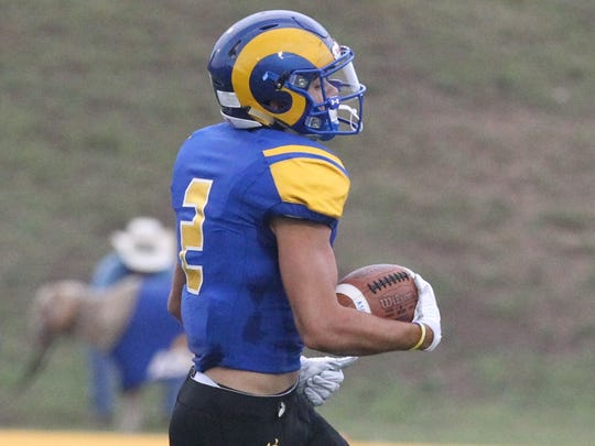 Angelo State University wide receiver Lawson Ayo eludes