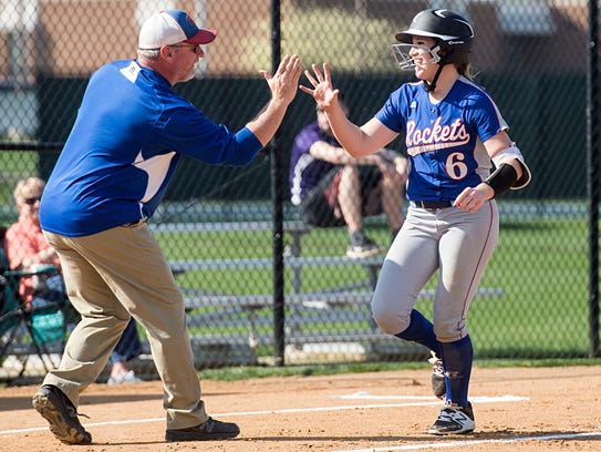 Spring Grove's Julia Wivell greets her coach as she