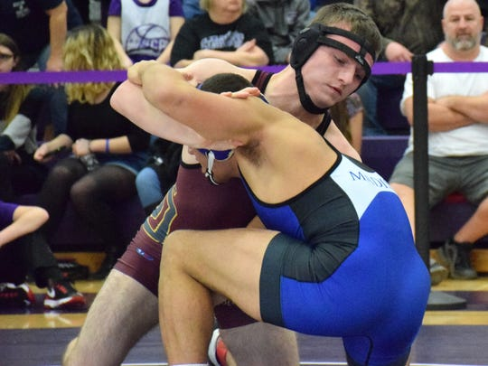 Stuarts Draft's Brandon Long, left, counters a move by Madison County's Zach Gibson during their 152-pound final at the Region 2A East wrestling tournament on Saturday, Feb. 11, 2017, at Strasburg High School in Strasburg, Va. Long lost on a technical fall n the third period.