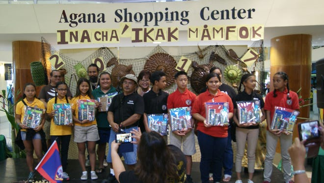 Category 4: 1st & 2nd Place Winner. The GDOE Chamoru Studies Division held a Mamfok Competition (Weaving) on March 19, at Agana Shopping Center. 1st Place, Inarajan Middle School. Pictured from left: Annabel Cing, Cameron Bernardo, Briann Taisipic, and Dai'ani Babauta (not pictured). 2nd Place, Agueda I. Johnston Middle School. Pictured from left: Weber Baiei, Jesse Quinata II, Dolina Seidler, and Kiana Ambros. Pictured back left:  Art Pangelinan(Judge), James Bamba(Judge), Sinora Velma Santos(Inarajan Middle School, CHamoru Language Teacher), Sinot Joseph Babauta(Marcial Sablan Elementary School, CHamoru Language Teacher and Mamfok Competition Committee Chair), Evangeline Iglesias(Wettengel Elementary School, Principal), and Sinora Michelle Balajadia(Agueda I. Johnston Middle School, CHamoru Language Teacher).