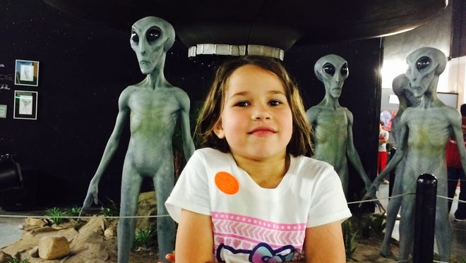 Erysse Elliott at the Roswell UFO Museum in Roswell, New Mexico. Offbeat, quirky places leave a memorable impression.