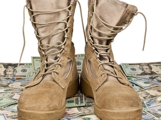army boots on background of money